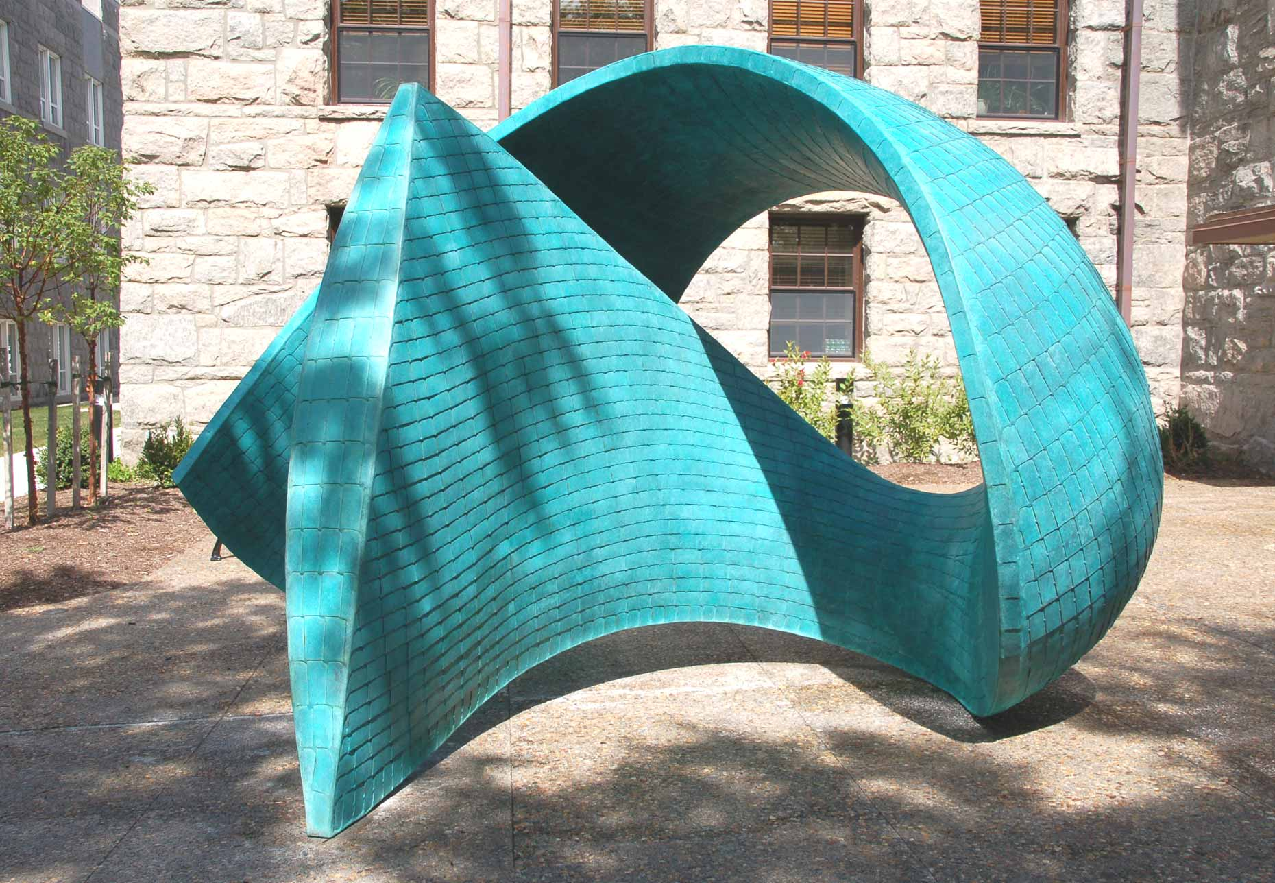 Torsion III a bronze sculpture By Peter Diepenbrock for The University of Rhode Island