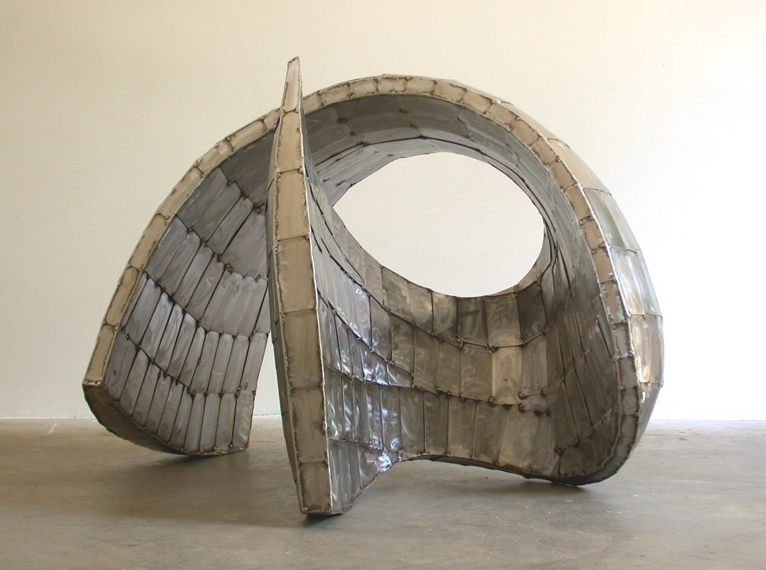 Torsion II in stainless steel by Peter Diepenbrock
